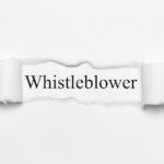 Whistleblower on white torn paper